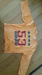 オレンジ色の長袖Tシャツ【100�a】