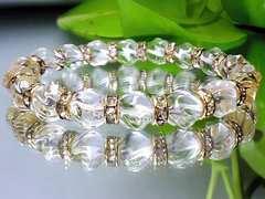 綺麗水晶トルネ-ド彫り水晶AAA8ミリ金ロンデル数珠