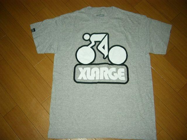 新品XLARGEエクストララージTシャツM灰系自転車ロゴ  < ブランドの