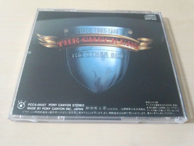 チェッカーズCD「The Other Side」THE CHECKERS● < タレントグッズの